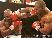 Evander Holyfield (left) and Mike Tyson have fought twice before