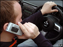A man using a mobile phone while at the wheel