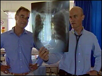 Prof Robert Wilkinson (on left) and Dr Graeme Meintjes examine the X-ray of a TB patient.