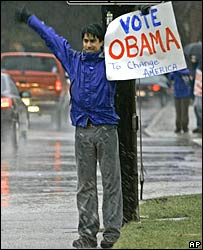 Arya Kamangar stands in the rain near a polling station in Columbus, Ohio, 4 March 2008