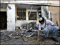 A resident of Sderot inspects the damage done to his home by rockets launched form Gaza (4 March 2008)