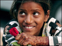 A girl in India who sells flowers for a living
