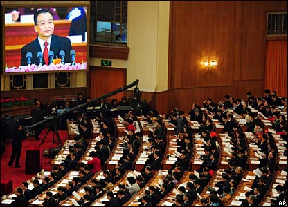 Chinese Premier Wen Jiabao appears on a big screen (L) while delivering his speech to top leaders and delegates (AFP)