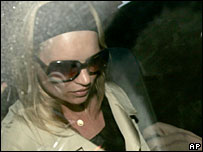 British supermodel Kate Moss is driven away from a police station in London on 31 Jan 2006 after being interviewed by detectives in about her alleged cocaine use