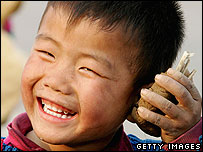 Boy holds sand mobile phone