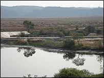 Border between China and North Korea marked by the Yalu River at Dandong, China