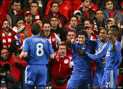 Chelsea celebrate the opening goal in front of Olympiakos's fans