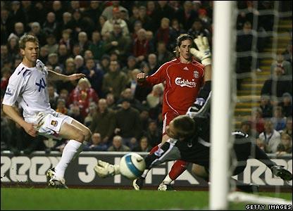 Torres beats Robert Green to make it 3-0