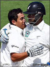 Ross Taylor (l) celebrates his century with Daniel Vettori