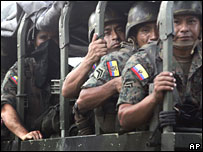 Ecuadorean troops ride to the border with Colombia on 5 March 2008