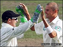 Chris Martin (right) took two late wickets to stun England