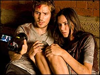 Michael Stahl-David and Odette Yustman in Cloverfield