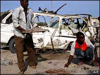 Mogadishu residents clear up after bomb (Feb 2008)