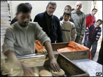 Gaza baker with queue for bread