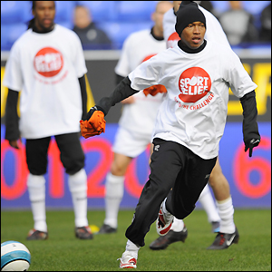 Bolton's El Hadji Diouf running with Ricardo Gardner, Joey O'Brien and Gretar Steinsson looking on