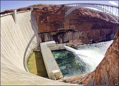 Water flows from the number one and two jet tubes as seen from atop the Glen Canyon Dam, 5 March 2008