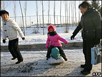 Parents with their child in Harbin, northern China, file image