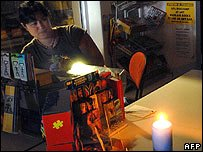 Woman using candle in a shop