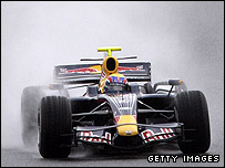 Mark Webber drives the new Red Bull in the wet