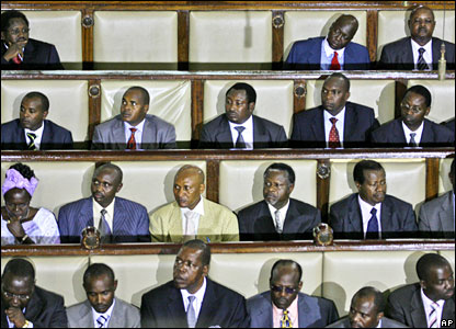 MPs listen as Kenyan President Mwai Kibaki addresses the opening session of parliament