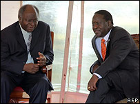 Kenyan President Mwai Kibaki and ODM leader Raila Odinga arrive at parliament