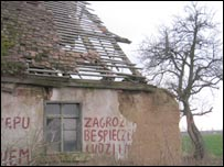 A dilapidated house with graffiti