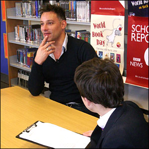 TV presenter Toby Anstis being interviewed by students from Desborough School in Maidenhead