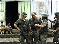 Army soldiers patrol a street of Dureno, on the Ecuadorean border with Colombia