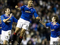 Daniel Cousin celebrates opening the scoring at Ibrox