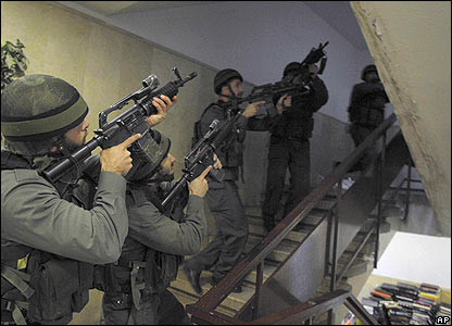Israeli special forces soldier searches Mercaz Harav seminary.