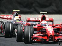 Ferrari's Kimi Raikkonen leads McLaren's Lewis Hamilton