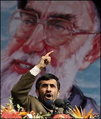 Mahmoud Ahmadinejad making a speech in front of a poster of Supreme Leader Ayatollah Ali Khamenei