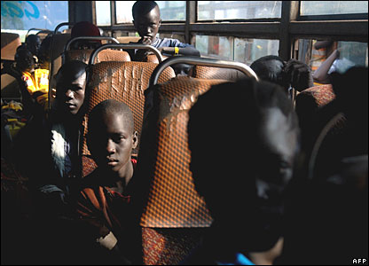 Sudanese refugees on a bus