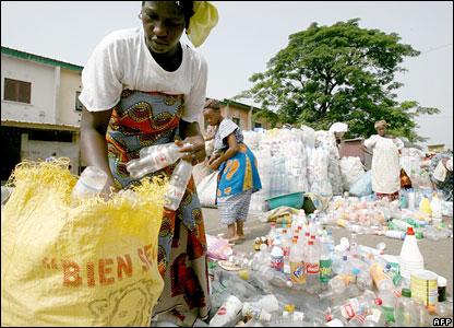 Women in Abidjan, Ivory Coast, sorting plastic bottles