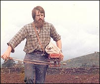 Andrew Whitley sows seeds using a fiddle drill in Cumbria in the 1970s