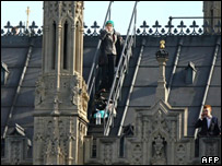 Protesters on the roof of the houses of parliament in London