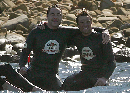 David Walliams and James Cracknell celebrate after swimming the Straits of Gibraltar