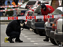 Police inspect the car park where Mr Carrasco was shot (7 March 2008)