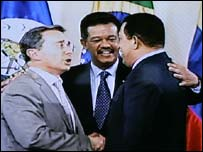 Television pictures of Colombia's Alvaro Uribe (left), Dominican Republic's Leonel Fernandez (centre) and Venezuela's Hugo Chavez