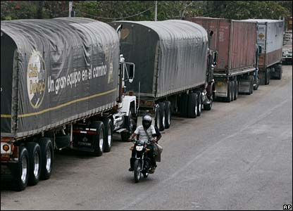 Trucks wait in line at a checkpoint in Paraguachon, on the Venezuelan border with Colombia, on Thursday