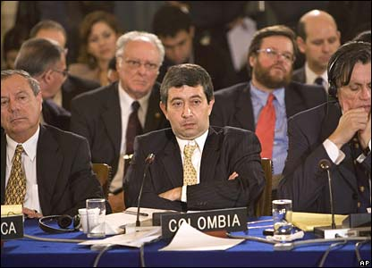Colombian envoy to the Organization of American States (OAS) listens to Venezuela's envoy read a statement at an emergency OAS meeting in Washington on Tuesday