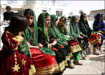 Girls dressed in traditional Afghan clothing attend a ceremony, in Kandahar province.