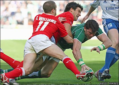 Mike Phillips pulls off a fine tackle on Shane Horgan