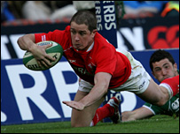 Wing Shane Williams dives over to equal the Wales try-scoring record