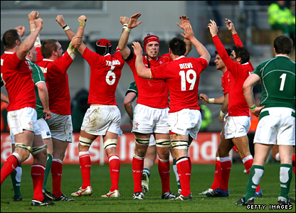Wales celebrate winning the Triple Crown as the final whistle blows