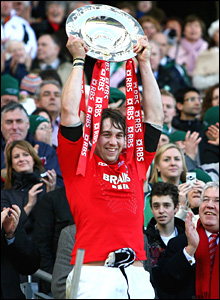 Wales captain Ryan Jones lifts the Triple Crown