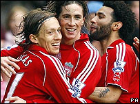 Liverpool players celebrate another Fernando Torres goal