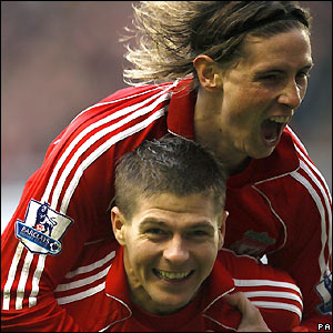 Gerrard and Torres celebrate