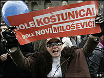 Belgrade protester with banner that reads Down with Kostunica, Down with New Milosevic, 11.02.08