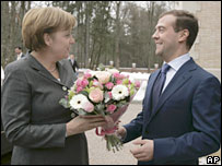 Russian President-elect Dmitry Medvedev greets German Chancellor Angela Merkel during their meeting outside Moscow